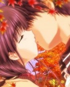 kissing couple in the leaves