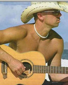 kenny shirtless with his guitar