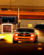 Free orange-camaro.jpg phone wallpaper by heyyourhot
