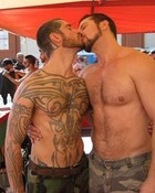 Logan and Vinnie kissing at the booth