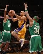 Derek_Fisher_drives_between_2_Celtics_players.JPG