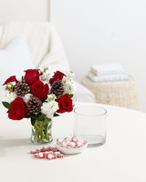 Red Roses, Pine Cones and White Carnations