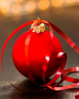 Red Christmas Ball on a wooden table