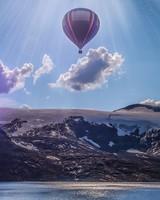 Hot Air Balloon Over Mountains