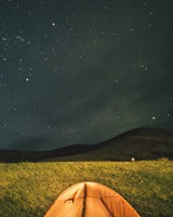 Tent under starry sky
