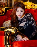 Beautiful Asian Woman, Red Luxury Sofa