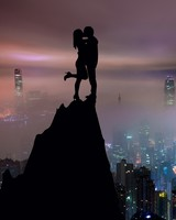 Couple, silhouettes, kiss, hill, city, skyscrapers