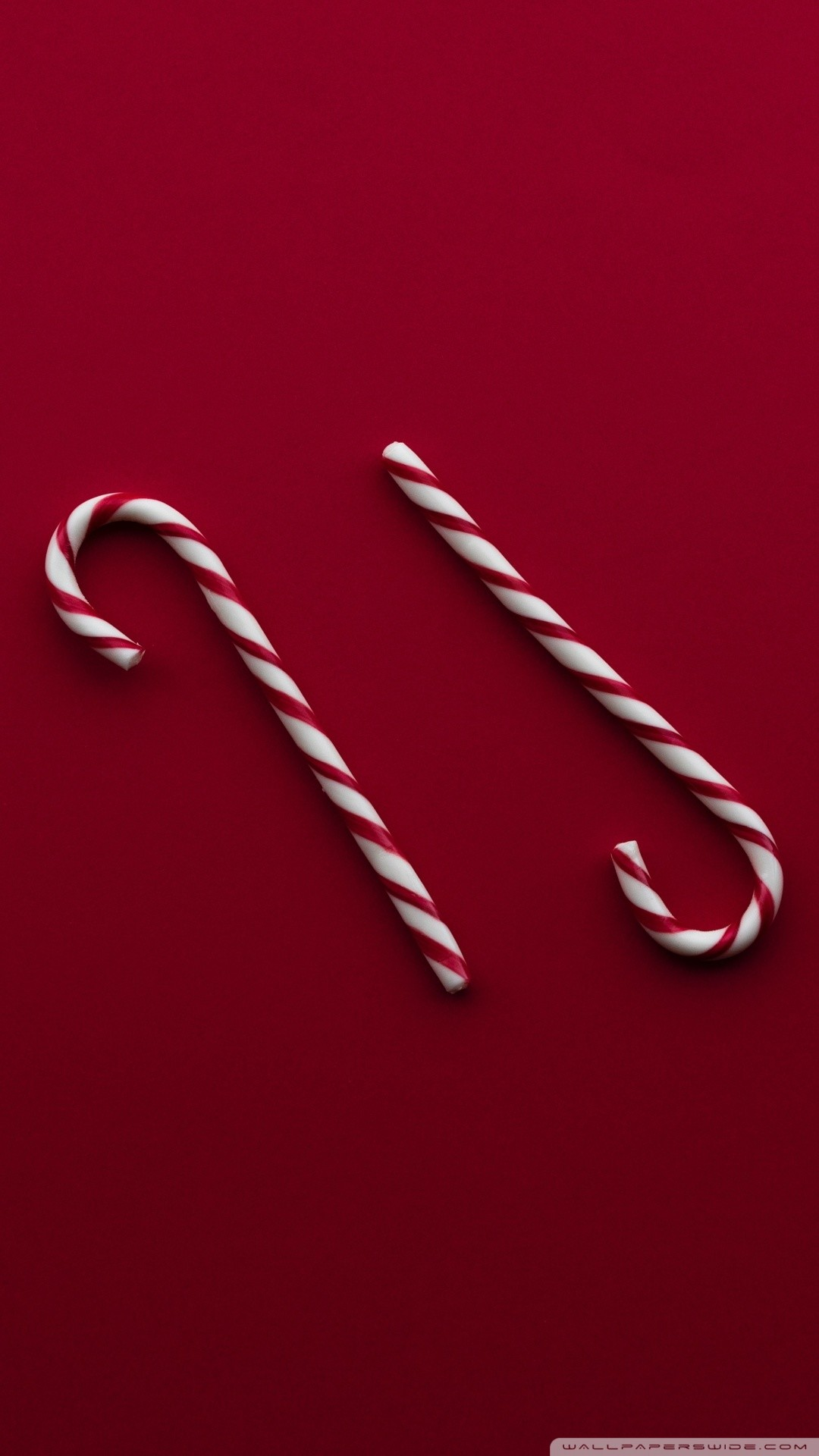 Free Christmas Candy Canes Red Background phone wallpaper by treymohme
