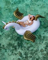 Woman, Floating Inflatable Gold Unicorn